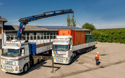 Road transport with crane trucks and open trucks